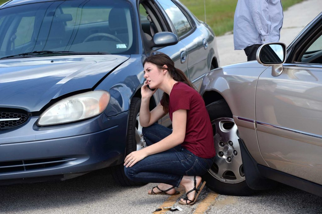 A woman contacting a lawyer after a car accident