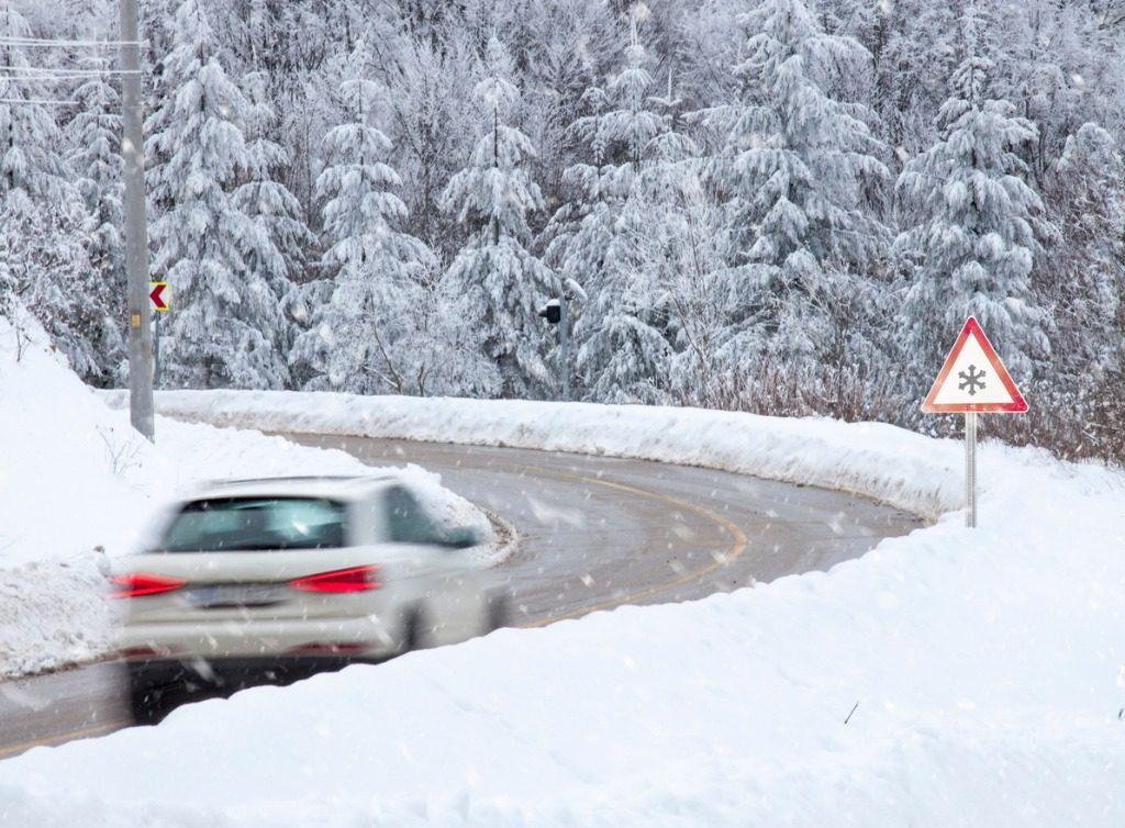 A car driving through danger snowy conditions which could result in damages