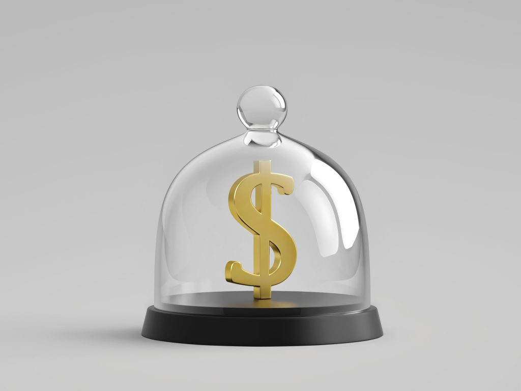 A physical gold dollar sign in a glass enclosure representing a trust